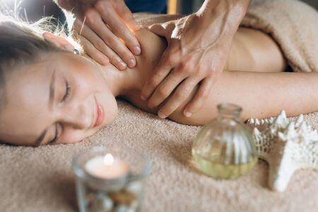 Body care. Spa body massage treatment. Woman having massage in the spa salon.