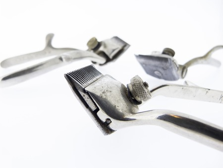 hair clippers: old hair clippers, 3 rustic scissors Hairdressing tool Stock Photo