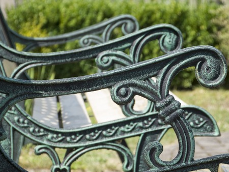 elaborate: elaborate ornaments, green bench to sit and rest Stock Photo