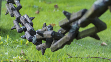 concatenation: an old iron chain - chain links from the Middle Ages - abstract Stock Photo