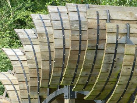 waterwheel: gristmill, sawmill - waterwheel, historic wooden wheel generation of energy Stock Photo