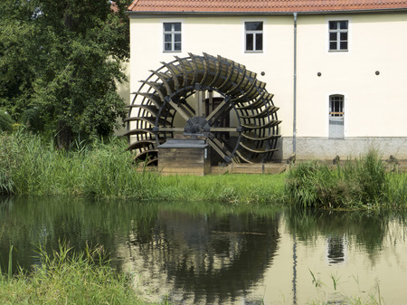 gristmill: gristmill, sawmill - waterwheel, historic wooden wheel generation of energy Stock Photo