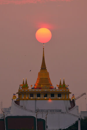 The Golden Mountain at Wat Saket in special moments  The Sun was on the top of Golden Mountain  photo