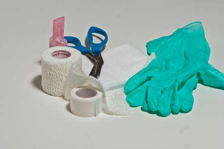 saline: Gauze,tape,cling,saline,and bandage sicissors for use in dressing changes. Stock Photo
