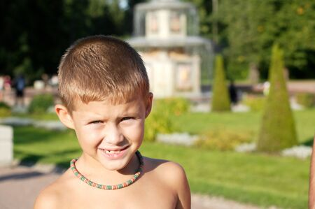 Boy in a summer park photo