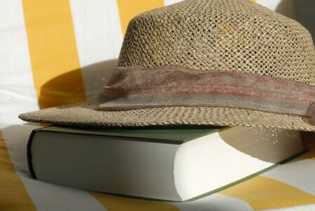 straw hat: straw hat and book Stock Photo