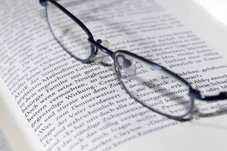 myopic: reading glasses on book