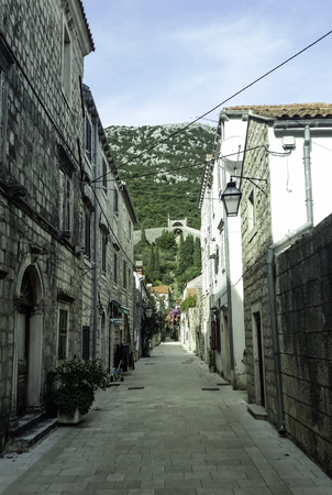 Narrow street in Ston with Great Wall in background in Ston, Dubrovnik - Neretva, Croatia