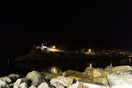 Statue of St Peter the Apostle over Makarska's waterfront by night in Makarska, Makarska Riviera, Dalmatia, Croatia