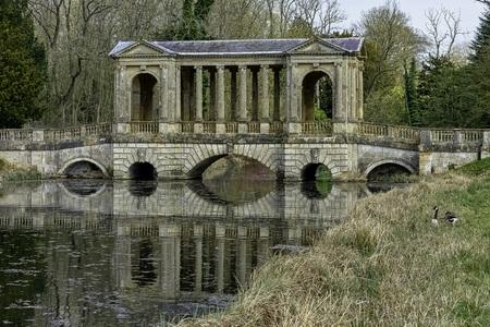 Octagon Lake and Palladian Bridge in Stowe, Buckinghamshire, United Kingdom 写真素材