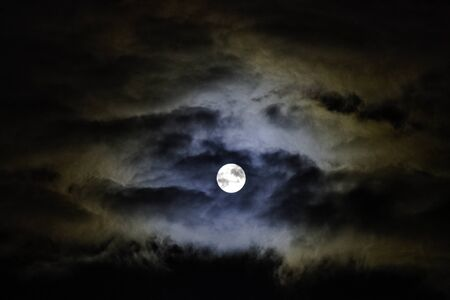 Dramatic night sky with full moon over United Kingdom Imagens