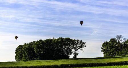 Hot air balloons over French fields - Dinan, France