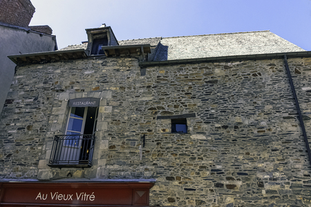 Vintage architecture of Old Town with Chateau de Vitre in background - Vitre (Vitré), Brittany, France