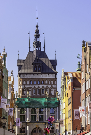 Vintage architecture of Old Town with Golden Gate and Amber Museum in background - Gdansk, Tricity, Pomerania, Poland