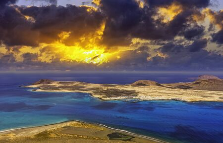 Sunrise over volcanic Island La Graciosa of the Atlantic Ocean - a view from Lanzarote, Canary Islands, Spain