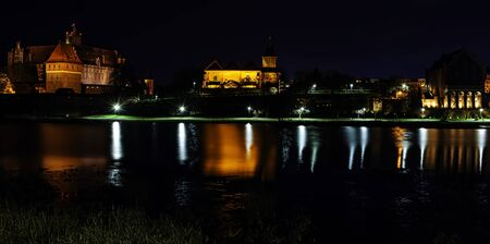 Castle of the Teutonic Order by night in Malbork, Pomerania, Poland Editorial