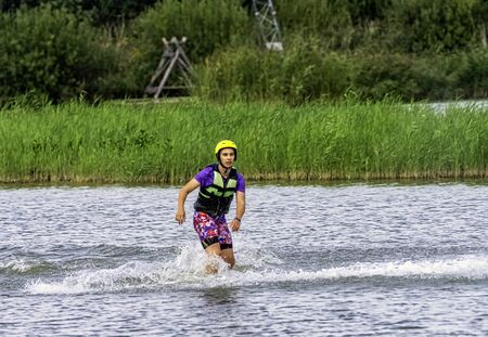 Teenager wakeboarding on a lake - Brwinow, Masovia, Poland