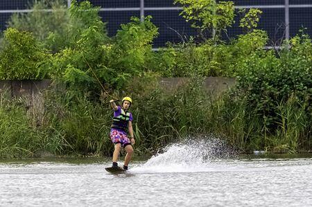 Teenager wakeboarding on a lake - Brwinow, Masovia, Poland