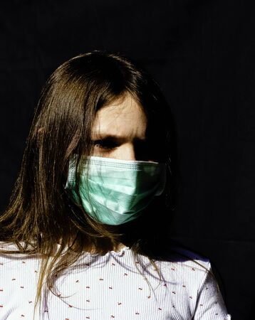 Portrait of girl wearing protective mask - London, United Kingdom