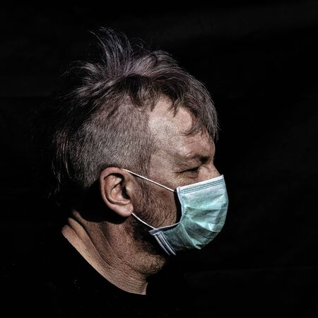 Portrait of male wearing protective mask - London, United Kingdom