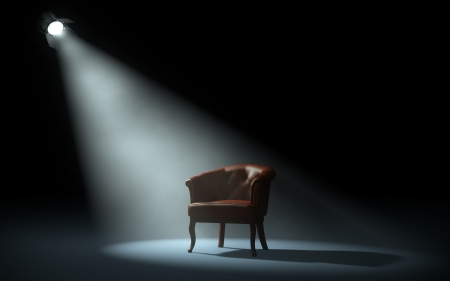 chair on stage under spotlight Imagens