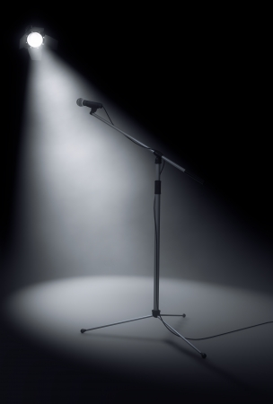 Microphone stand on stage Stock Photo