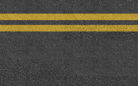 road travel: Double Yellow Line On New Asphalt Road texture background