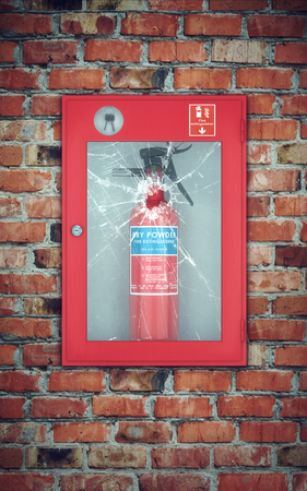 glass brick: Fire extinguisher in wall box with cracked glass. brick wall background