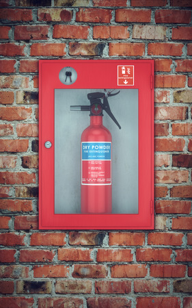 Fire extinguisher in wall box. brick wall background Zdjęcie Seryjne