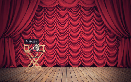 Director's chair on stage with red curtains background