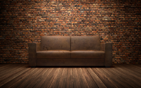 Old leather sofa in empty room with brich wall. 3d rendering