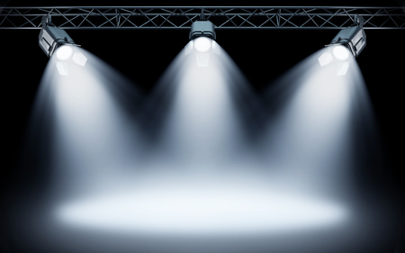 Bright stage spotlights shining on dark background. 3d rendering