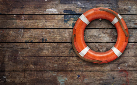 Lifebuoy on rough wooden wall. 3d rendering