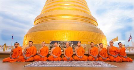 thai monk: thai monk with big pagoda Editorial