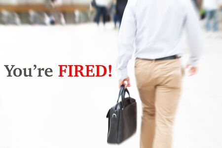 layoff: motion blur businessman. you are fired, humanresource concept