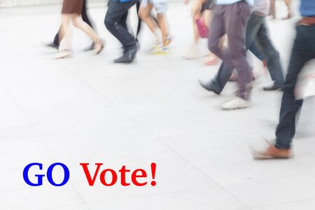 libertarian: motion blur people walking, election concept