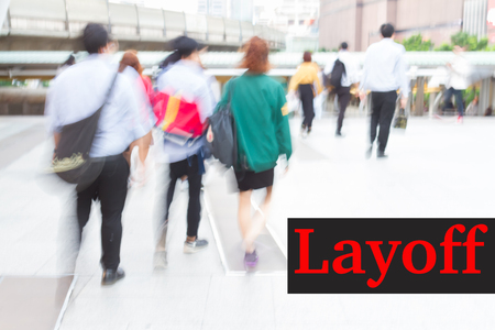 lay off: motion blur crowd walking background, lay off concept