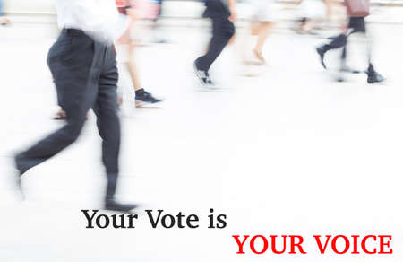 libertarian: motion blur businessman walking, election concept