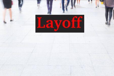 dismiss: motion blur crowd walking, unemployment concept