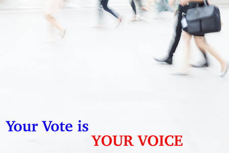 libertarian: motion blur people walking, business management concept