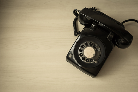 telephone: black retro old telephone, view from top, vintage effect Stock Photo
