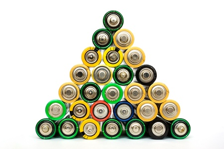 Detail of many assorted AA batteries stacked in a pyramide isolated on a white background photo