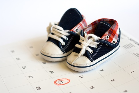 due date: Due date in the calendar and the baby shoes