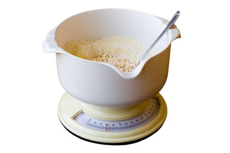 kitchen scale: Kitchen scale with flour isolated on white background Stock Photo