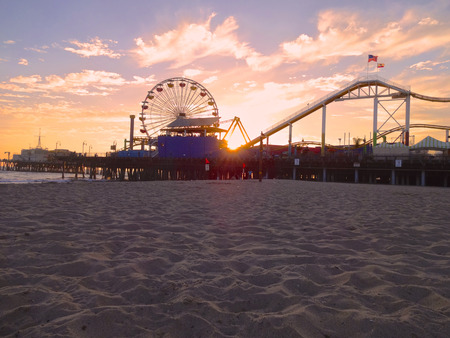 A view of the Santa Monica Beach just before the sun goes down for the evening.  photo
