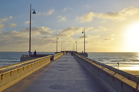 A beautiful summer sunset in Venice Beach, California.