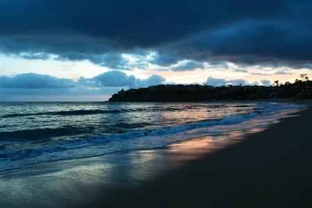 A Stormy Sprintime Sunset in Emerald Bay, Laguna Beach. Laguna Beach is a town in Southern California Reklamní fotografie
