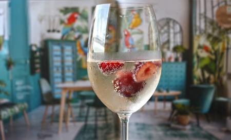 Closeup shot cherry bubbles champagne alcohol fresh fruit drink