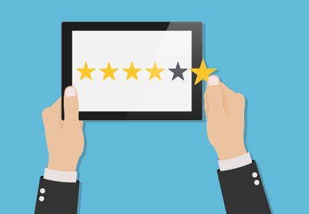 Hand holding tablet with yellow rank stars on screen. Concept of feedback. Template design of voting, rating, customer reviews and evaluation. Vector illustration