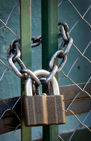 padlock suspended by two chains photo